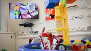 TV showing a children's programme, in the Children's Ward at Royal Preston Hospital