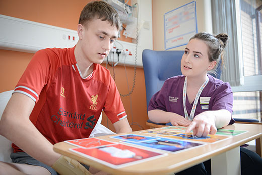 A nurse providing support to a teenage patient for the Lancashire Teaching Hospitals Charity